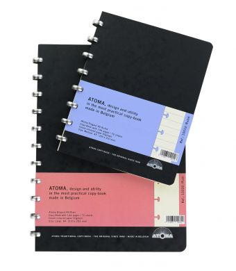 Disc-bound notebooks with black traditional card covers and aluminium discs filled with cream paper.