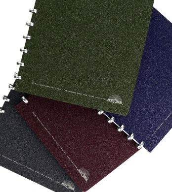 Disc-bound notebooks with textured richly-coloured covers and aluminium discs filled with white lined paper.